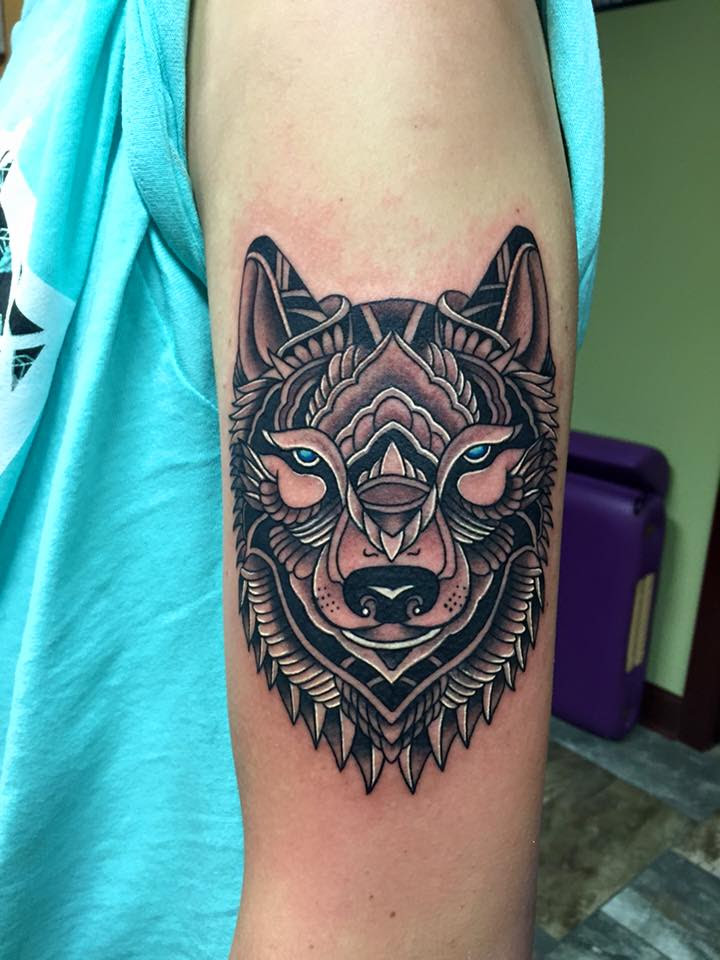 Modern geometric and mandala wolf head tattoo by Tyler of Neon Dragon in Cedar Rapids, Iowa
