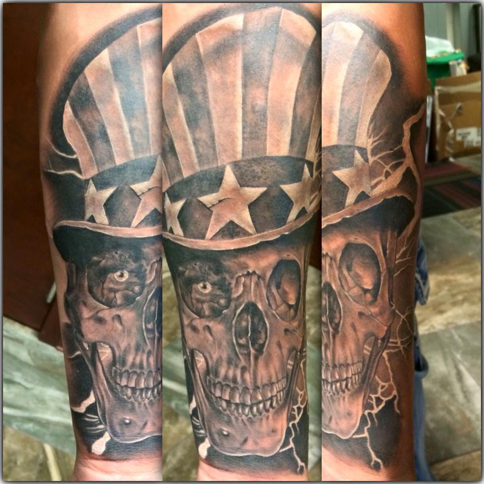 Black and gray Uncle Sam skull head tattoo by Tyler of Neon Dragon in Cedar Rapids, Iowa