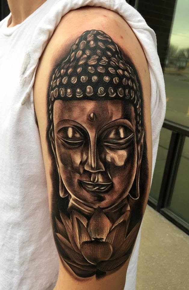 Realistic Buddha head tattoo by Tyler of Neon Dragon in Cedar Rapids, Iowa